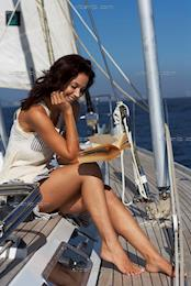 Beautiful woman reading on yacht (BG_100325)