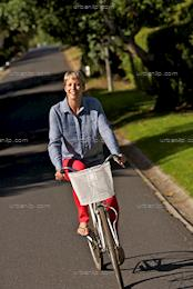Mature woman riding her bicycle  (BS_104271)