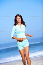 Beautiful brunette standing on beach (CC_100031)
