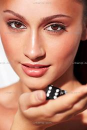 Close-up of glamorous young woman holding lucky dice (CM_100457)