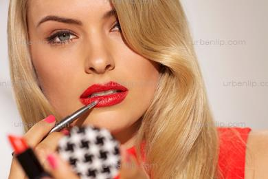 Beautiful blonde woman applying red lipstick in compact mirror  (CS_101844)