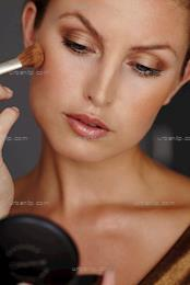 Beautiful woman applying make-up.  (CX_100565)