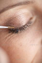 Close up of eye makeup application (AA_101369)