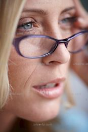 Close up of beautiful blonde woman wearing glasses (AA_101362)