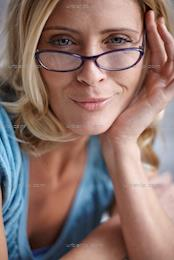 Portrait of beautiful blonde woman wearing glasses (AA_101359)