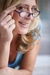 Portrait of beautiful blonde woman wearing glasses (AA_101350)