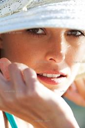 Close-up portrait of girl in sun hat (AS_101002)