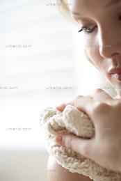 Close up of natural woman washing her face with wash cloth (AS_105473)