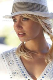 Head and shoulders of blonde girl in hat (AS_106530)